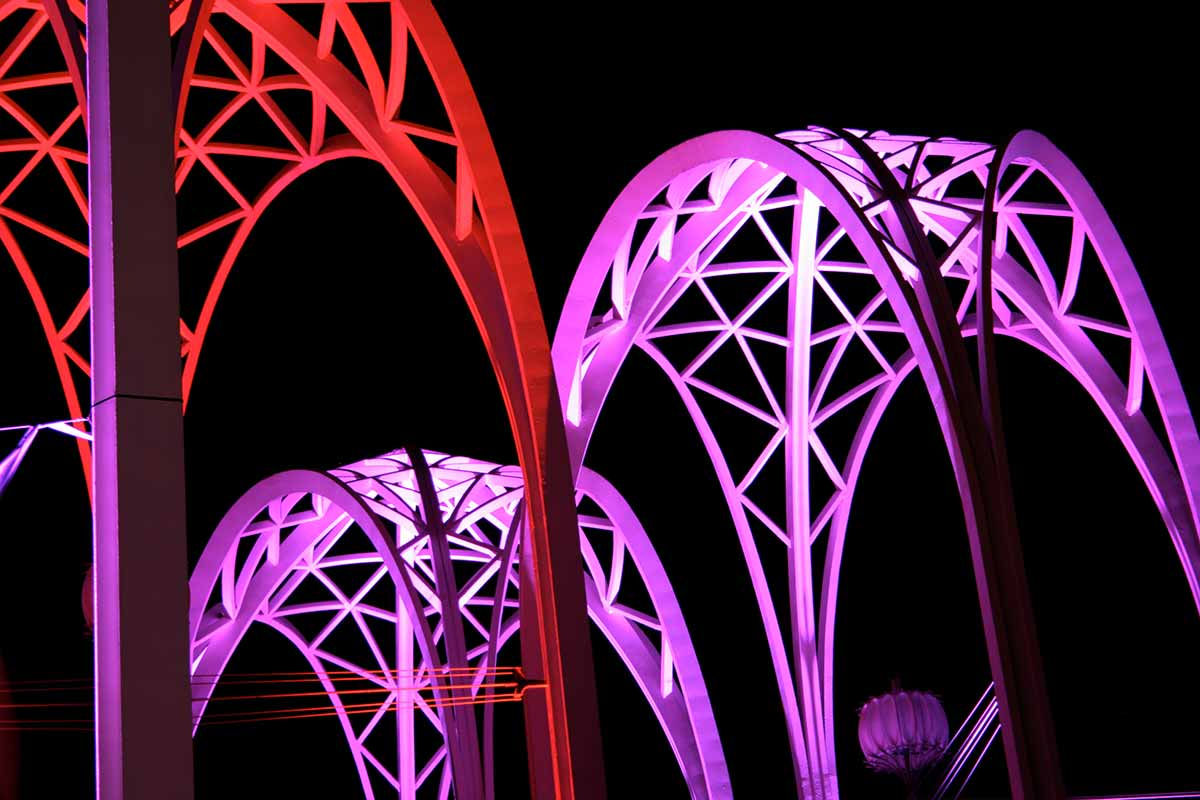 Purple and red lit arches above the Pacific Science Center in Seattle