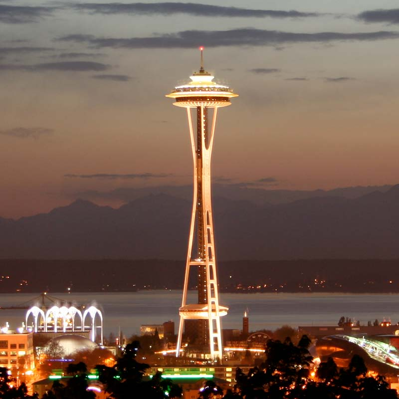 The Space Needle and Pacific Science Center in Seattle at dusk.